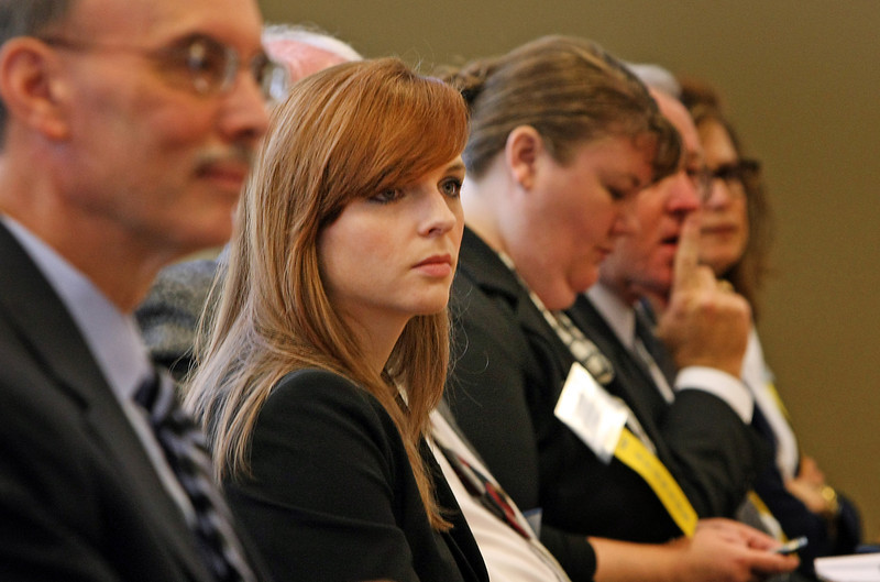 Audience members listen to the presentations at the Tulsa Regional Chambers Health Care Forum concerning the physician shortage in Oklahoma.