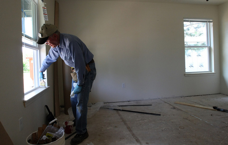 Terry Dicacon work on one of several Habitat for Humanity houses under construction in west Tulsa.