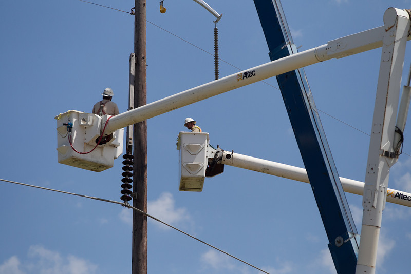 Utility from neihboring states and around the country were in high gear restoring electricity in Moore, OK after an EF5 tornado cut a 17 mile path through town.