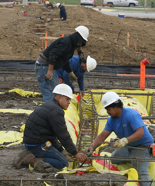 Workmen lay the foundation for a Raising Cains restaurant  in Broken Arrow.