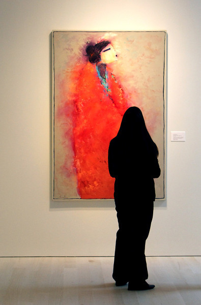 Abbey Rodgers studies a painting on display at the Philbrook Downtown museum.