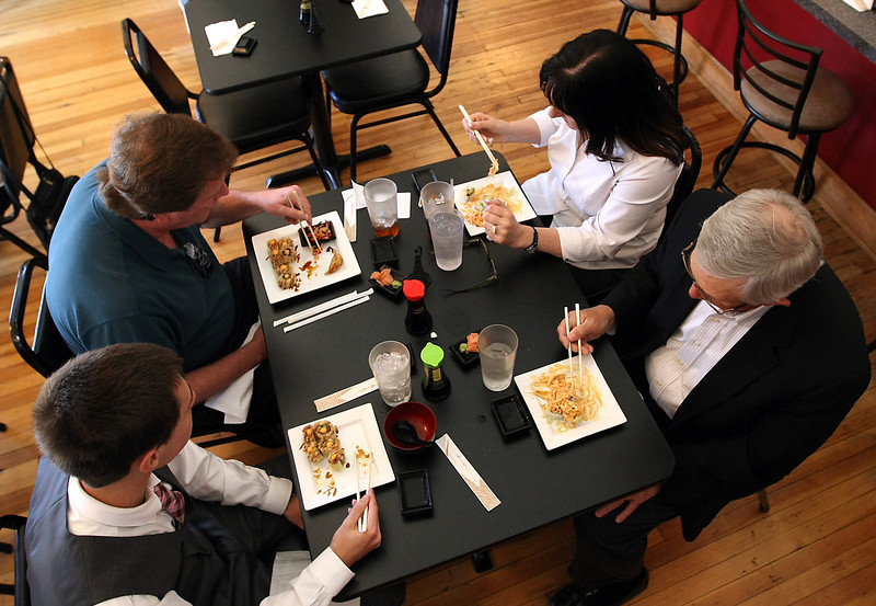 Kevin Hayes, an attorney with Hall Estill,  enjoys a healthy sushi lunch with friends at The Sushi Place in downtown Tulsa.