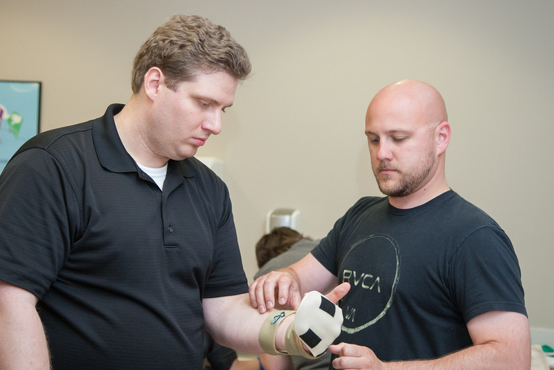 Chris Tirello, an Occupational Therapy student, builds a splint during a laboratory session for Argyle Woodruff, a Physical Therapy. Tirello and Woodruff practice building custom splints in Carrie Ciro's laboratory, professor of Occupational Therapy, at the University of Oklahoma's College of Allied Health.