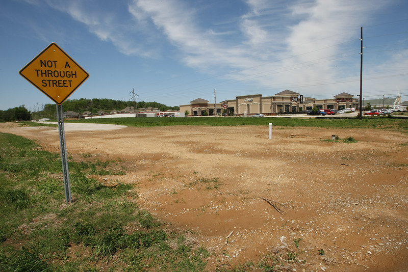 An affiliate of Tulsa's P&H Properties paid $5.48 million for 12.38 acres of highly visible dirt nestled just between Bass Pro Shops and the Target-anchored Shops at Broken Arrow.