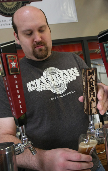 Eric Marshall draws a sample of the the beer he brews at Marshall Brewery in Tulsa.