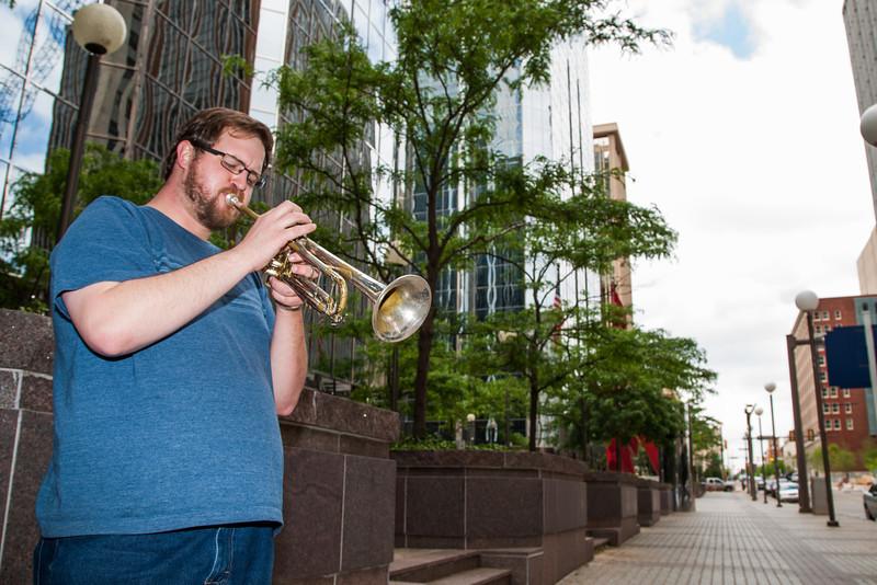 Jazz trumpter Jon Kratzer  plays on the corner of Park Ave. and Robinson in downtown Oklahoma City, OK.