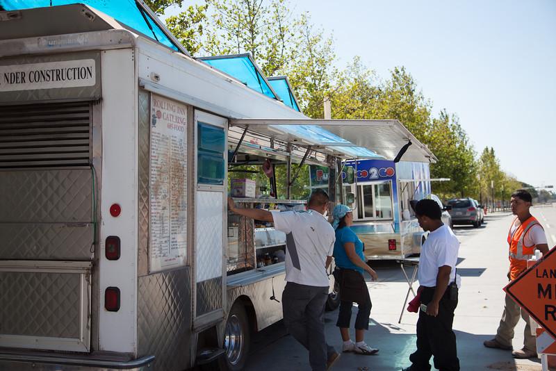 Food trucks serving customers at the Myriad Gardens.