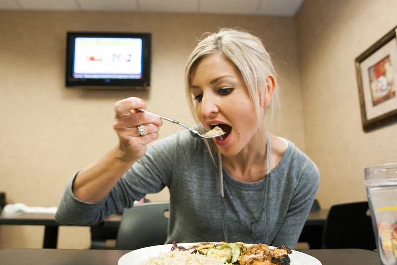 Britney Brucker eating one of the five healthy meals she eats daily.