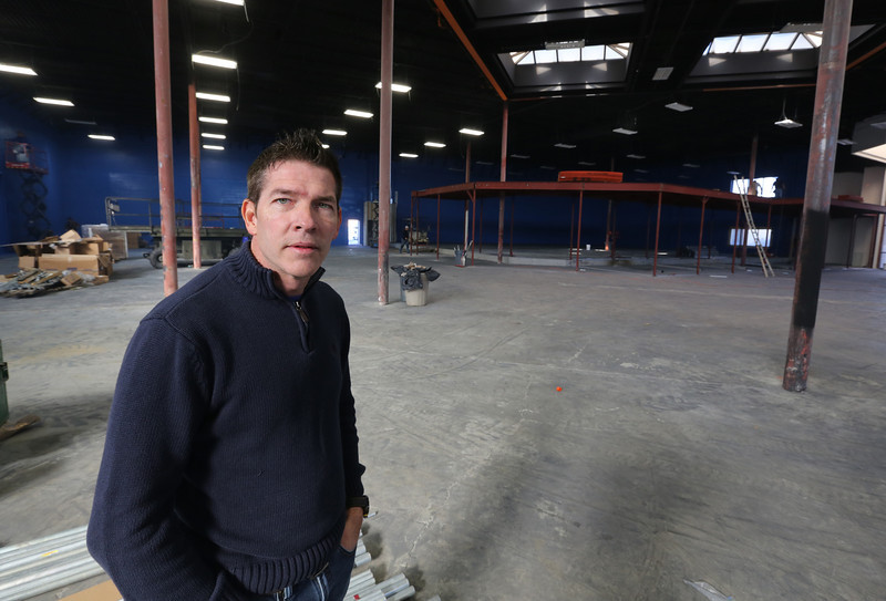Keith Snyder, General Manager of Sky Zone, oversees the construction of the indoor trampoline entertainment complex in Tulsa.