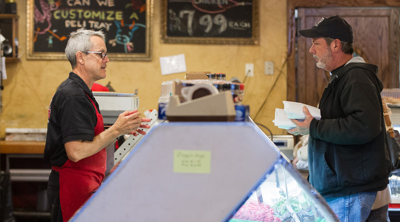 Bill Kamp (left) prepares an order for a customer at Kamps Deli in Oklahoma CIty, OK.
