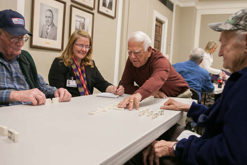 Former Governer George Nigh plays dominos with Oklahoma vets in the governer's conferance room.