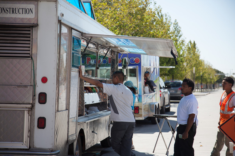 Food trucks serving customers at the Myriad Gardens.