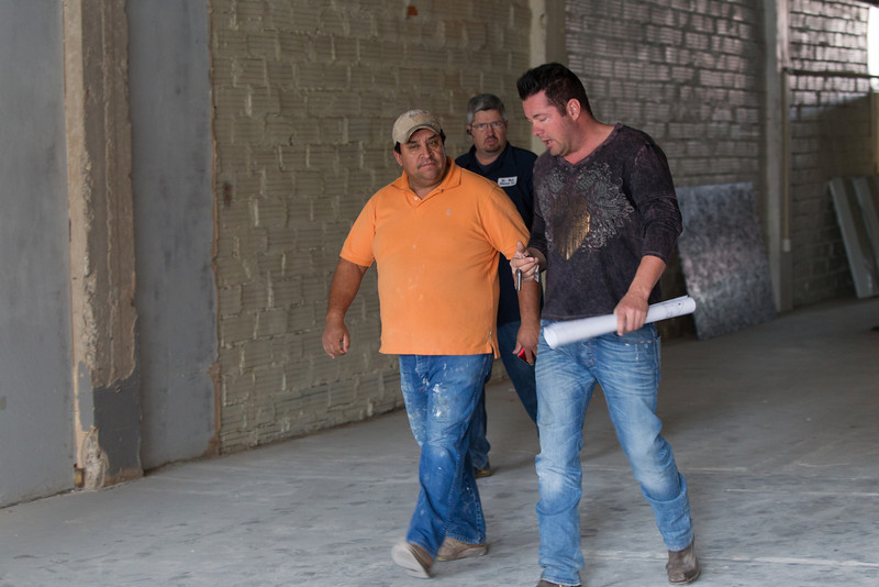 Contractors walk through the future location of Water's Edge Winery in down town Oklahoma CIty, OK.