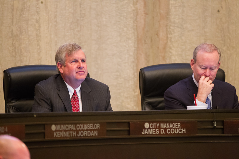 Oklahoma City Manager James Couch sitting to the left of mayor Mick Cornett at a tuesday morning city council meeting.