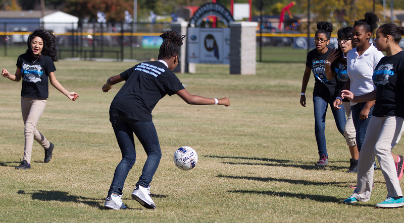 Girls playing soccar after lunch on the new sports fields at Webster Middle School in Oklahoma City, OK.