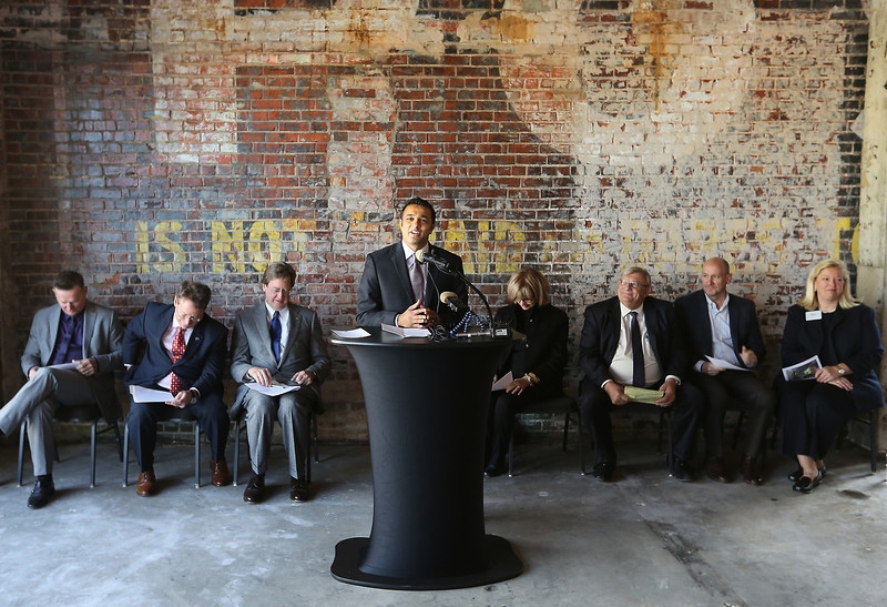 During a press conference Paresh Patel, President and CEO of Promise Hotels, announces that he will build a new Hilton Garden Inn on the site in downtown Tulsa.