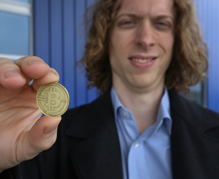 Ryan Underwood holds a Bit coin.