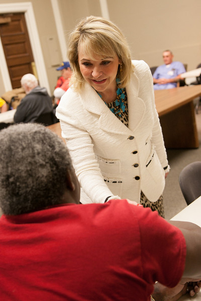 Governer Mary Fallin meets with vets playing dominos in the governor's conferance room at the state capitol.