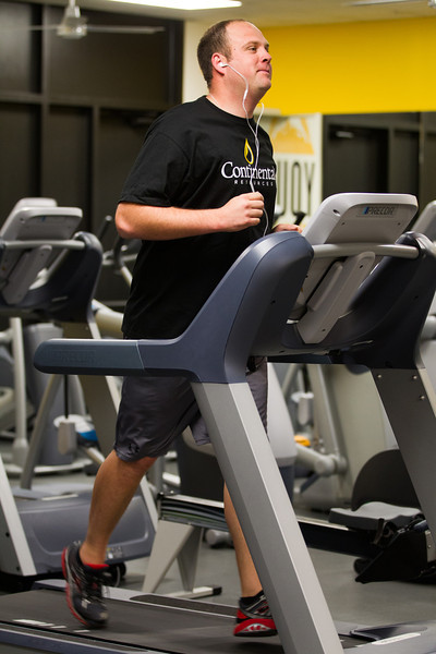 Dustin Minton working out in the gym at Contintal Resources.
