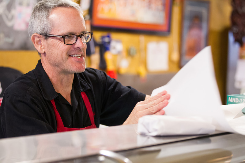 Bill Kamp prepares an order for a customer at Kamps Deli in Oklahoma CIty, OK.