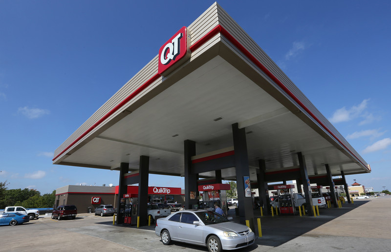 Jim Hill fills his vehicle with gasoline at a QT store in south Tulsa.