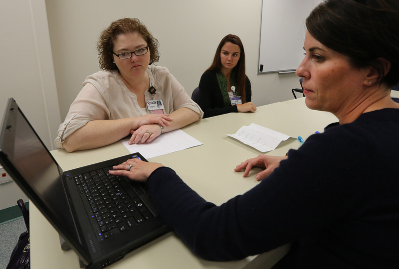 Jennifer KClark M.D. (right) instructs two students Michelle Mills and Aly Sparkman on palliative care.