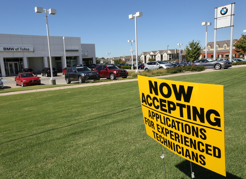 Help wanted sign outside the BMW Tulsa dealership.
