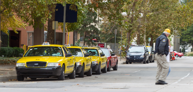 Taxi cabs on Main Steet in downtown Oklahoma CIty, OK.