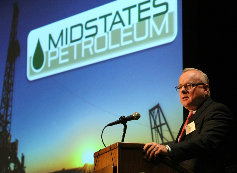 John Crum, CEO of Midstates Petroleum, gives his presentation at the Friends of Finance luncheon Tuesday in Tulsa.
