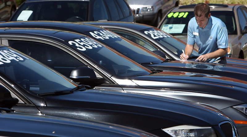 John Oglesby, a manager at BMW Tulsa completes  paperwork for cars on his lot.  Oklahoma's personal income grew less than 1 percent in the second quarter, only a slight uptick from the 0.6 in the first quarter, according to estimates released on Monday by the U.S. Bureau of Economic Analysis.