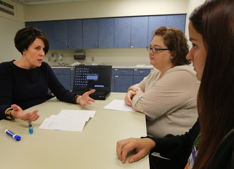 Jennifer KClark M.D. instructs two students Michelle Mills and Aly Sparkman on palliative care.