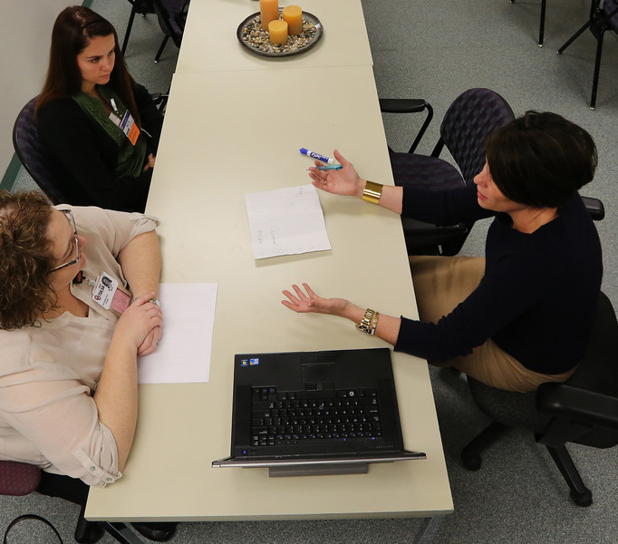 Jennifer K. Clark M.D. (right) instructs two students Michelle Mills and Aly Sparkman on palliative care.