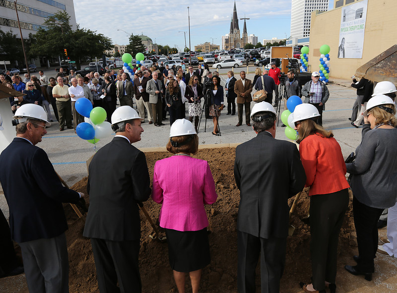 Dignitaries turn dirt at the ground breaking of the TCCs Nate Waters Physical Therapy Clinic expansion in downtown Tulsa.
