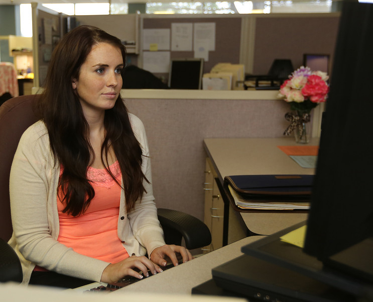 Child Welfare Specialist Amy Welch at her workstation at the DHS office in Tulsa.