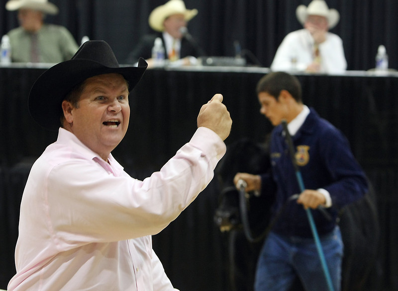 Ringmaster Stacy Lee wrangles bids at the Junior Livestock Auction at the Tulsa Sate Fair.