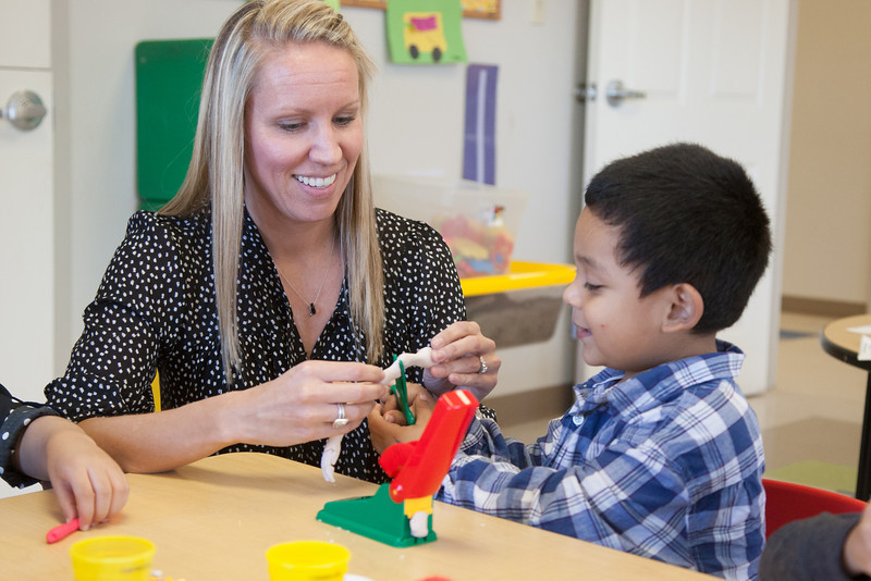 Teacher Liz Moore and Danny Villanueva at Early Foundations Family Outreach, a daycare at Mayflower Church that specializes in working with autistic children.