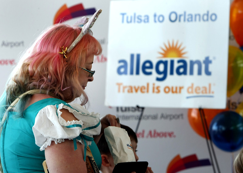 Kristi Roe-Ownes waits to board the first Allegiant Airlines flight  from Tulsa to Orlando Florida Friday.