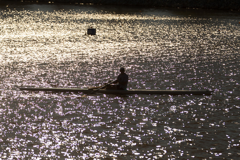 A man rowing at the Oklahoma River at the boathouse district in Oklahoma City, OK.