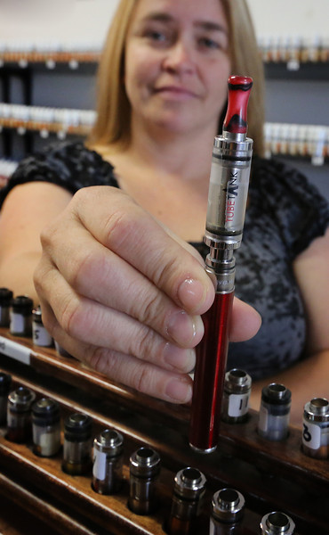 Kimberly Franks a salesman at Enigma Vapor in Tulsa shows a popular model for sale at the establishment.