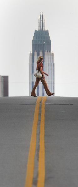 A pedestrian crosses Boston Ave at 3rd street in downtown Tulsa.