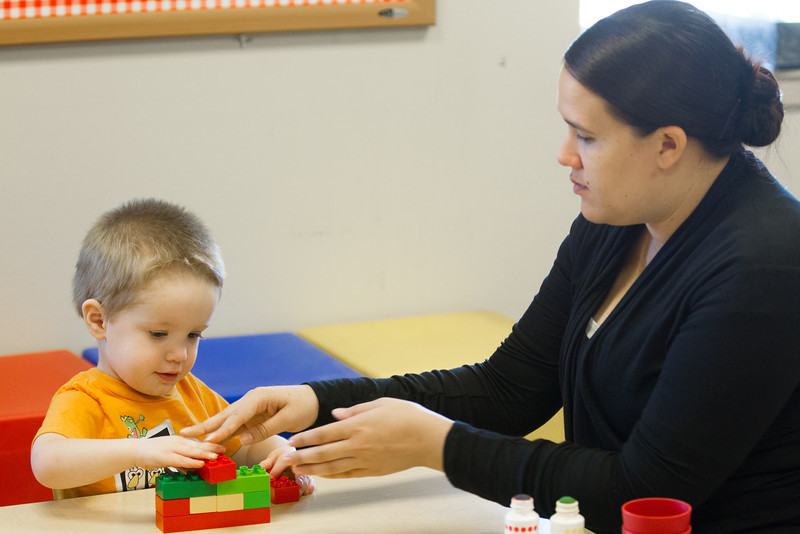 Marissa Johnson works with Eli Johnson at Early Foundations Family Outreach, a daycare at Mayflower Church that specializes in working with autistic children.