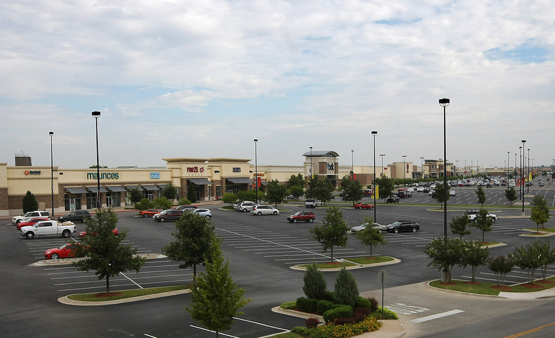 Owasso's Smith Farm Marketplace, a shopping center that played a huge role in that northern Tulsa suburb's huge retail expansion has sold to an investment group from Columbia, Mo. for $49 million .
