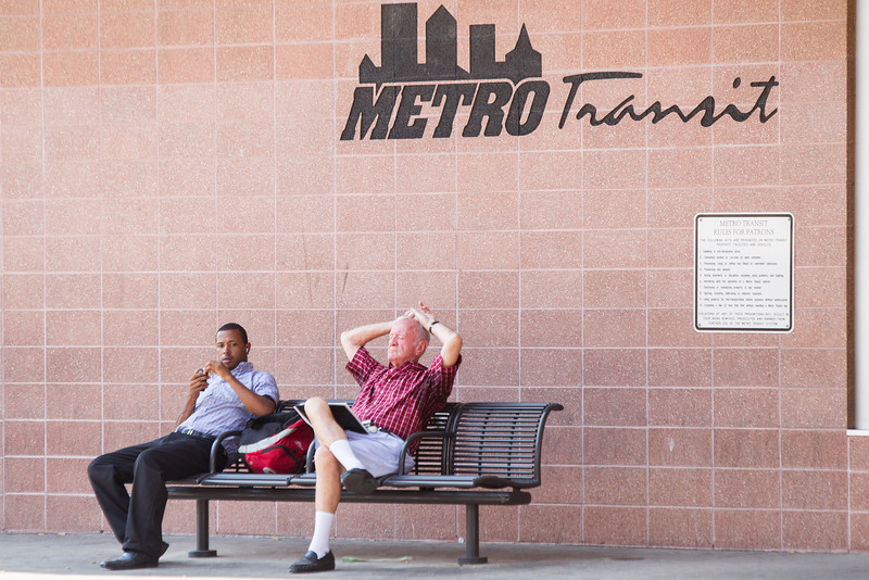 Two men wait for a bus at the Metro Transit bus station in downtown Oklahoma City.