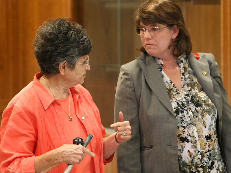 Frances Minter, wife of Jay Minter the WW II veteran who was scalded to death visits with Rogers County District Attorney Janice Stiedley prior to the unsealing of indictments in the Claremore Veterans Administration case in June..