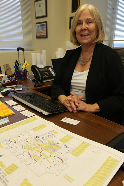Janet Meshek pauses for a photo at her Tulsa office.