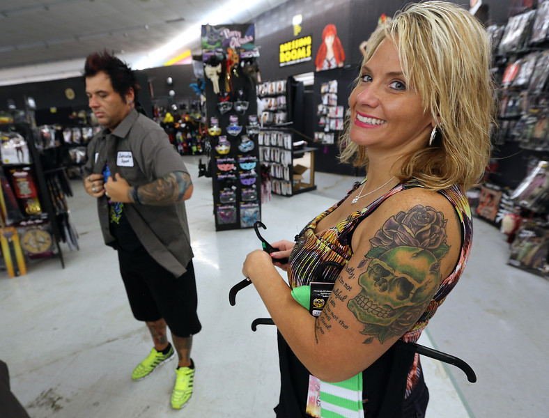 Rob and Christina Whitecotton of Jenks get an early start on their costume shopping at the Spirit Halloween shop in Bixby.