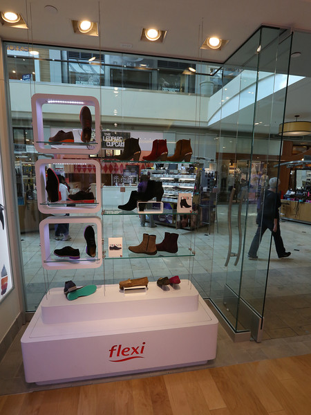 Mexican shoe producer and retailer Flexi Group opened its first Oklahoma store Thursday in 1,050 square feet on Woodland Hills Mall's lower level.