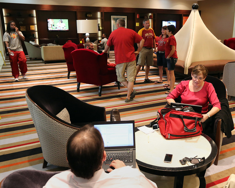 Iowa Sate football fans check into the Hyatt Hotel in downtown Tulsa in preparation for Saturdays game against Tulsa University.