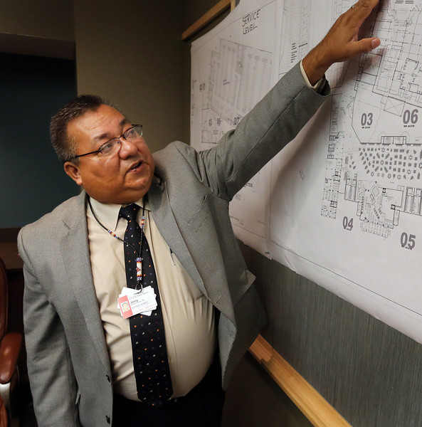 River Spirit Casino General Manager Jerry Floyd gestures towards plans as he explains that the tribes new casino's budget now stands at $334 million.