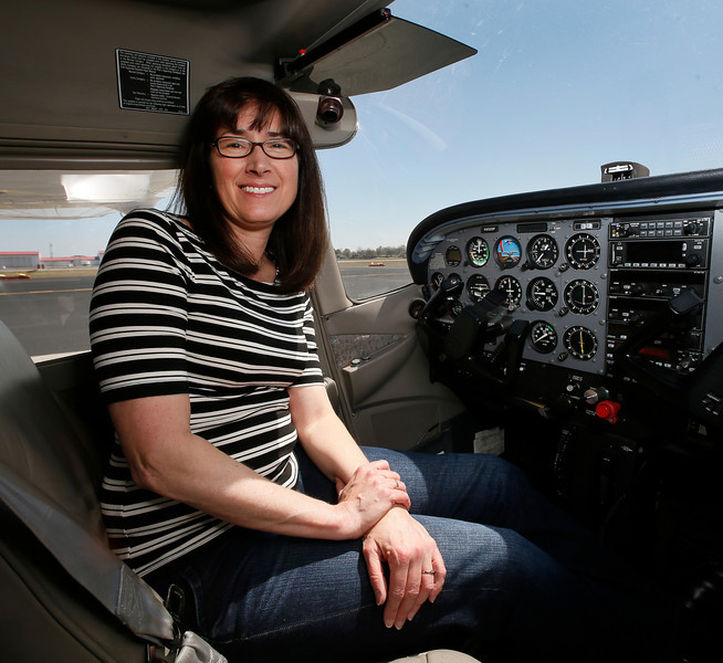 Jennifer Wise, Check Pilot and pilot for Southwest Airlines, in the cockpit of a small plane at the Jones airport in Jenks.